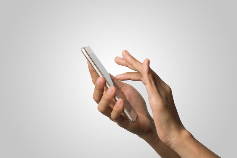 Woman Hand holding smart phone blank screen. Copy space. Hand ho